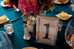 Table decorations of pink hydrangeas and silver picture frame