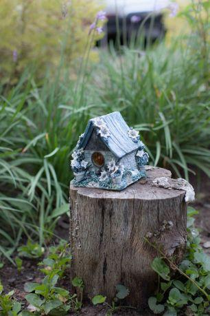 blue ceramic birdhouse