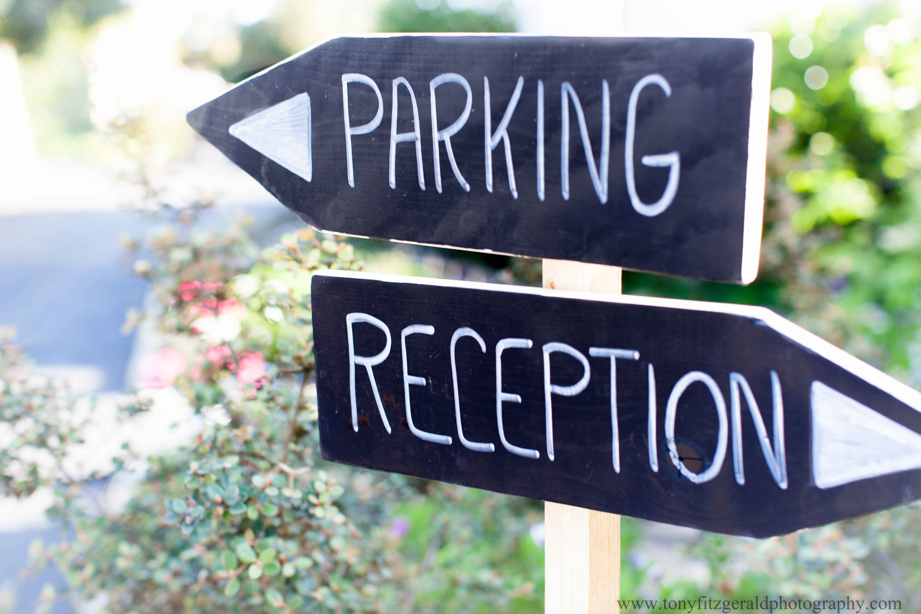 blackboard reception and parking signs