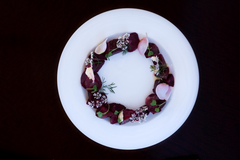 Beet salad with rose petals and cilantro flowers